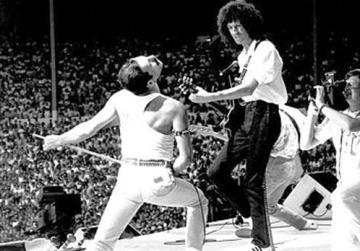 Freddie Mercury and Brian May rock Live Aid in 1985.