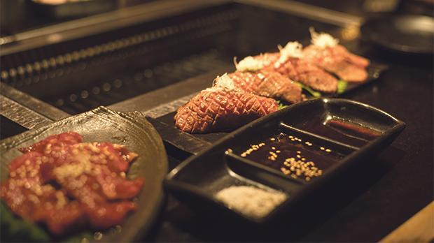 Yakiniku - beef barbecue at table.