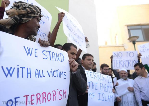 The Maltese Muslim community holds a demonstration against terrorism after Friday prayers in the grounds of the Paola mosque on December 11. Photo: Matthew Mirabelli