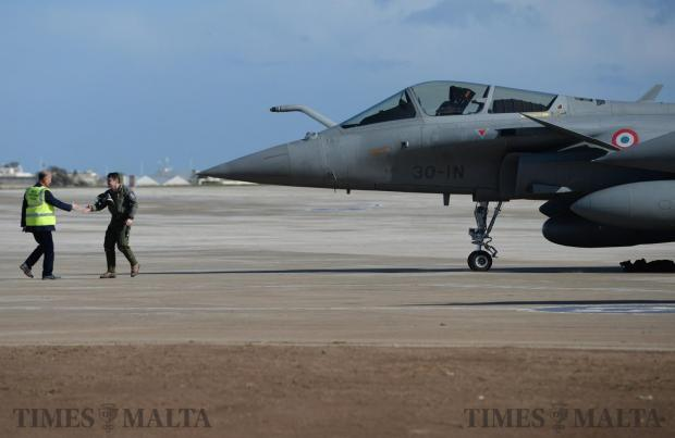 The pilot of a French Rafale fighter jet is greeted after landing in Malta after the KC135 refueling aircraft it was travelling with developed a technical fault and was diverted to Malta on January 16. Photo: Matthew Mirabelli