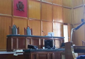 Businessman threathened wife with knife in front of children, court hears