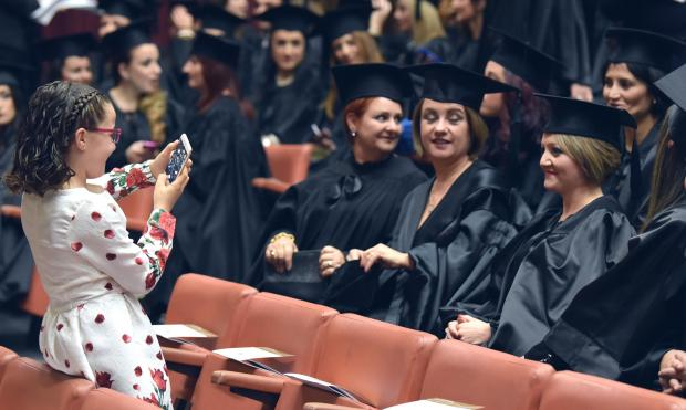 A girl takes a photo of graduates during a graduation ceremony at the University of Malta on November 21. Photo: Mark Zammit Cordina