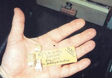 The molars in the palm of Anton Mifsud's hand when he first started investigating them in 1995.