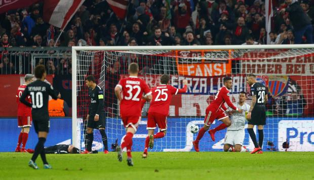 Bayern Munich's Corentin Tolisso celebrates scoring their third goal.