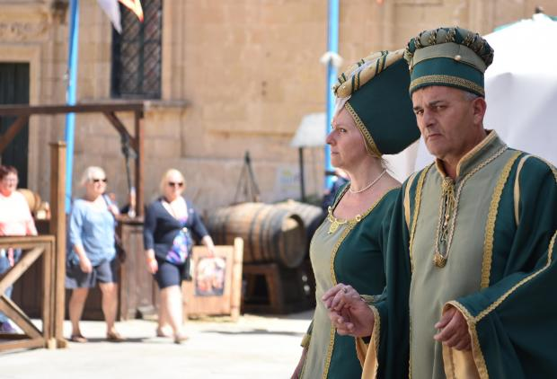 Two reenactors walk through the streets of Mdina during the Medieval Mdina Festival on May 06. Photo: Mark Zammit Cordina