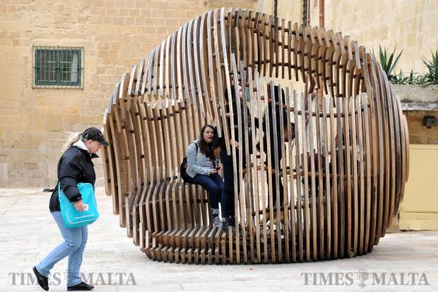Children shelter in a street sculpture in Valletta on December 19. Photo: Chris Sant Fournier