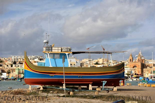 A Luzzu waits out the winter at Marsaxlokk on December 28. Photo: Chris Sant Fournier