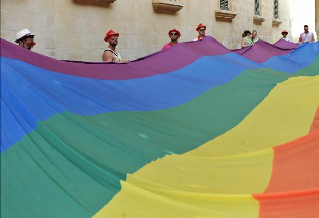 A huge rainbow coloured banner is carried through the Valletta streets as part of the Gay Pride on September 9. Photo: Chris Sant Fournier