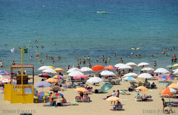 People take to the beach in Golden Bay on August 10 as the whole island slows down during the Santa Marija week. Photo: Matthew Mirabelli