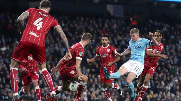 Manchester City's Kevin De Bruyne has a shot blocked during the Carabao Cup Semi Final, First Leg match at the Etihad Stadium.