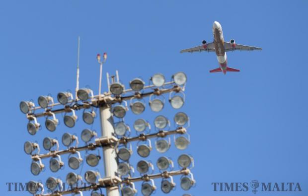 An Air Malta aircraft flies over the National Stadium in Ta'Qali on April 23. Photo: Matthew Mirabelli