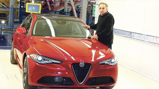 Fiat Chrysler Automobiles CEO Sergio Marchionne poses next to a new Alfa Romeo car during an event at an FCA plant in Cassino, southern Italy, in November 2016. He died last month. Photo: Tony Gentile/Reuters