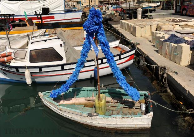 A little boat is decorated for the festa in Marsaxlokk on August 10. Photo: Chris Sant Fournier
