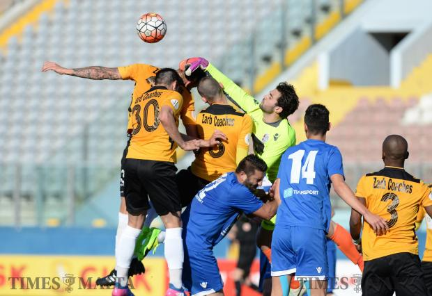 Mosta goalkeeper Andreas Vella punches the ball away against Sliema Wanderers during their Premiership match at the National Stadium in Ta'Qali on April 23. Photo: Matthew Mirabelli