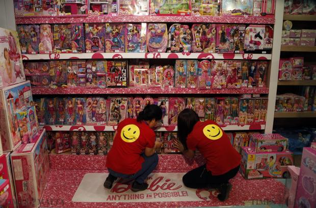 Shop assistants organise a shelf of Barbie dolls at a toy shop in San Gwann on December 8. Photo: Darrin Zammit Lupi