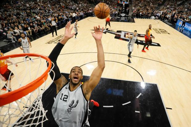 San Antonio Spurs power forward LaMarcus Aldridge (12) reaches for a rebound during the first half against the Utah Jazz at AT&T Center. Photo Credit: Soobum Im-USA TODAY Sports