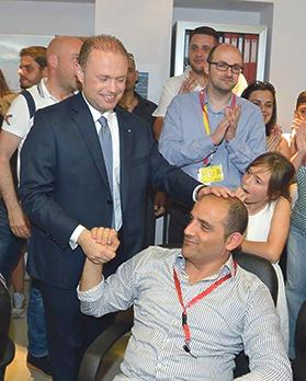 Joseph Muscat and James Piscopo at Labour headquarters soon after the party's election victory last year.
