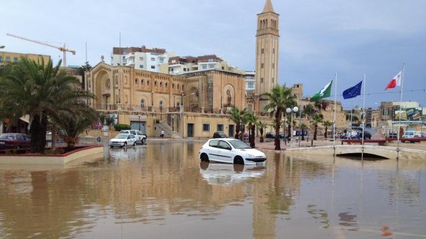 "The flooded square in Marsascala, with a stalled car in the middle. Picture Kurt Sansone - <a href=""mailto:mynews@timesofmalta.com"" target=""_blank"">mynews@timesofmalta.com</a>"