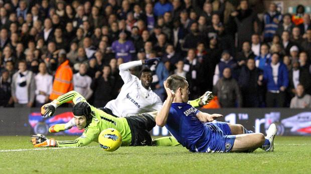 Chelsea's goalkeeper Petr Cech (left) looks on as John Terry (right) blocks a shot from Tottenham Hotspur's Emmanuel Adebayor (centre, back) during the Barclays Premier League match at White Hart Lane, London. Photo: Nick Potts/PA Wire.
