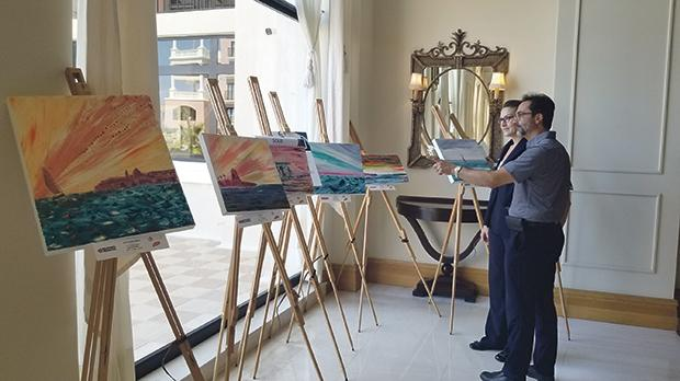 Victor Grech setting up one of the first exhibitions at the Westin.