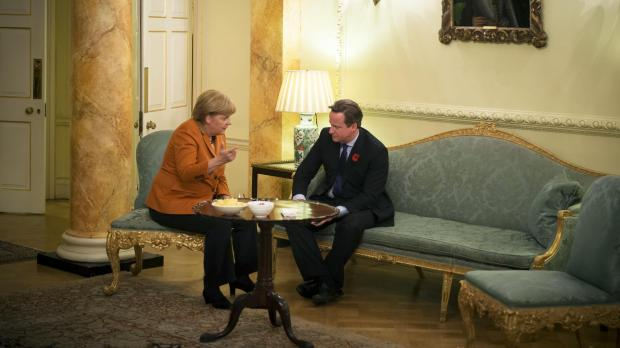 Britain's Prime Minister David Cameron and German Chancellor Angela Merkel speak at the start of their meeting at Downing Street.