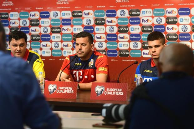 Cosmin Contra (centre) speaking to the media with Ianis Hagi on his right