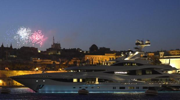 Fireworks in the distance give a touch of colour to the superyacht Lionheart at Vittoriosa waterfront on July 16. The £100 million luxury vessel was owned by former BHS owner Sir Philip Green, who sold it in Malta. Photo: Mark Zammit Cordina
