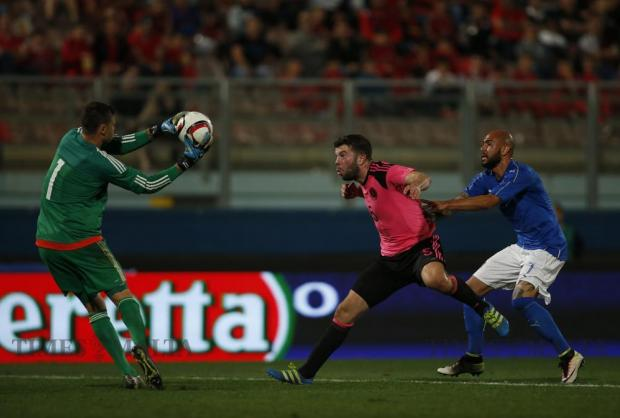 Scotland's goalkeeper David Marshall snatches the ball ahead of teammate Grant Hanley and Italy's Simone Zaza during their friendly football match at the National Stadium in Ta'Qali on May 29. Photo: Darrin Zammit Lupi