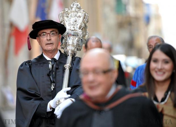 The University mace is carried in a procession to initiate the graduation ceremony of November 30. Photo: Chris Sant Fournier