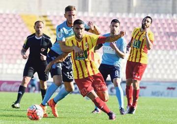 Birkirkara's Miguel Alba pulled back by Leonardo Incorvaia, of Sliema.