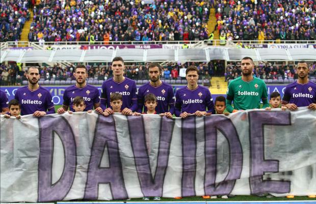 Fiorentina players hold a banner in honour of their captain Davide Astori who passed away last Sunday.