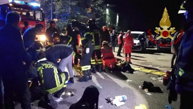 Emergency personnel attend to victims of a stampede at a nightclub in Corinaldo, near Ancona, Italy.