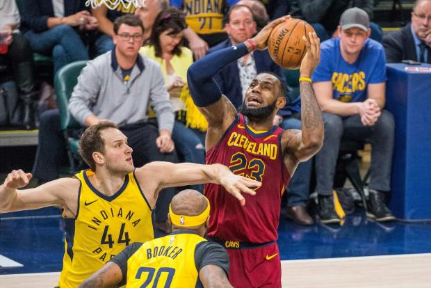 Cleveland Cavaliers forward LeBron James (23) shoots the ball while Indiana Pacers forward Bojan Bogdanovic (44) defends in the second half of game four in the first round of the 2018 NBA Playoffs at Bankers Life Fieldhouse. Photo Credit: Trevor Ruszkowski-USA TODAY Sports