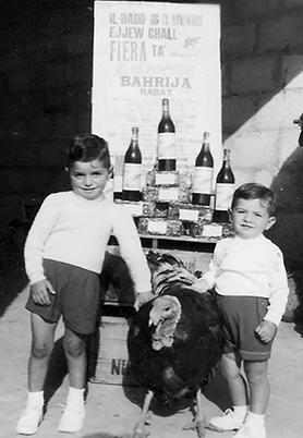 Children posing with a turkey, one of the traditional prizes of the fair – a custom which is no more.