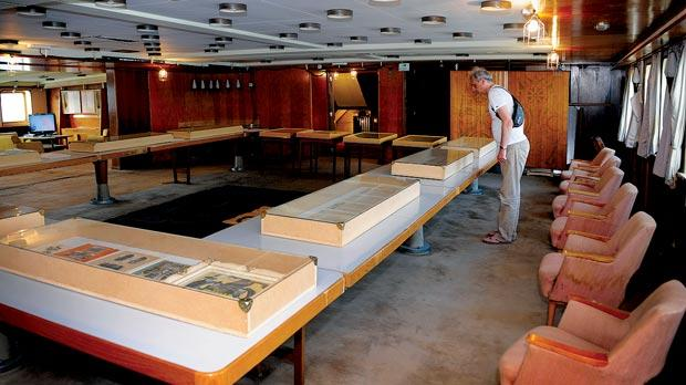 A visitor looking at multi-media tems during an exhibition inside late Yugoslav communist leader Tito's famous ship Galeb (Seagull) in Croatia's main harbour of Rijeka. Teh items are on display on three of the yacht's five decks.