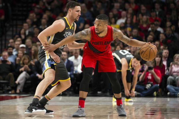 Portland Trail Blazers guard Damian Lillard (0) dribbles the ball as he is guarded by Golden State Warriors guard Klay Thompson (11) during the first half at the Moda Center. Photo Credit: Troy Wayrynen-USA TODAY Sports