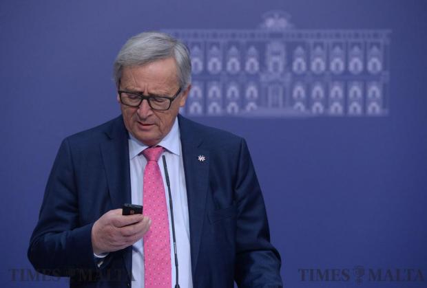 President of the European Commission, Jean-Claude Juncker (left) checks his phone during a press conference in Valletta on January 11, as Malta undertake the Presidency of the EU. Photo: Matthew Mirabelli