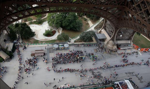 Long queues, short tempers. Photo: Reuters
