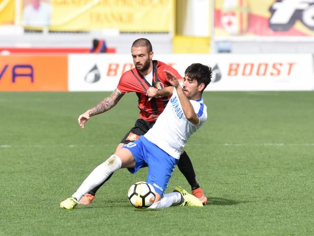 Mosta's Giordano Trovade holds off the challenge of Spartans' Mauro Criaco. During a football match held at the Ta' Qali Stadium on February 25. PHOTO: MARK ZAMMIT CORDINA