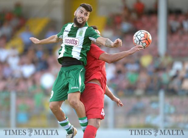 Floriana's Mario Fontanella (left) jumps for the ball during their Premiership match against Pembroke Athleta at the Hibernians Stadium in Corradino on August 20. Photo: Matthew Mirabelli