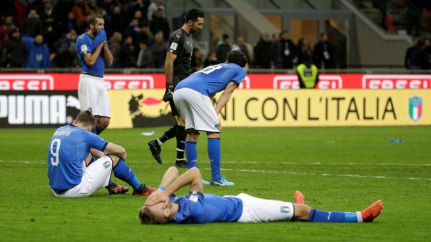 Italy players in despair after missing out on a place in next year's World Cup finals.