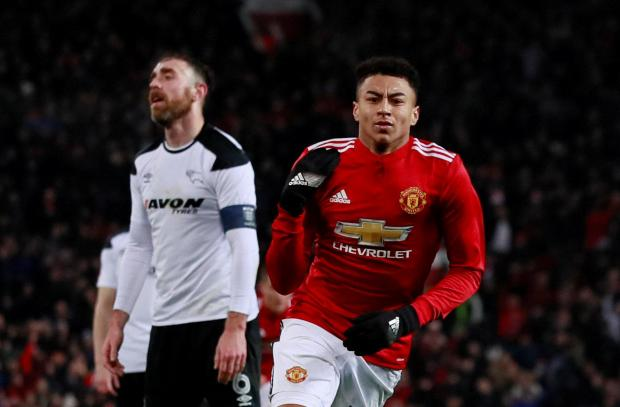 Manchester United's Jesse Lingard celebrates scoring their first goal.