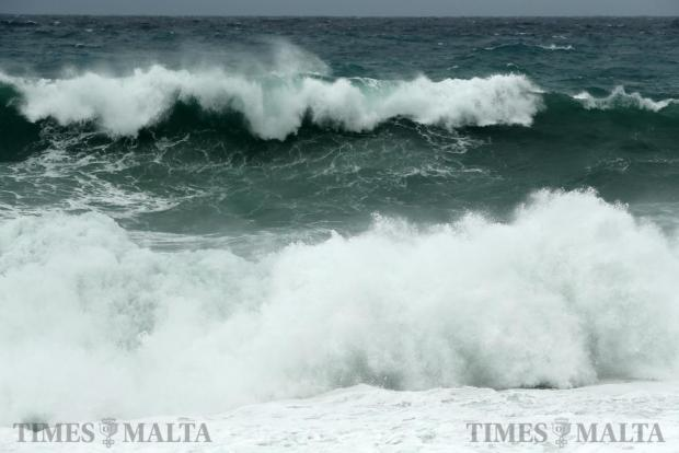 Waves crash ashore at Fond Ghadir in Sliema on December 17. Photo: Darrin Zammit Lupi