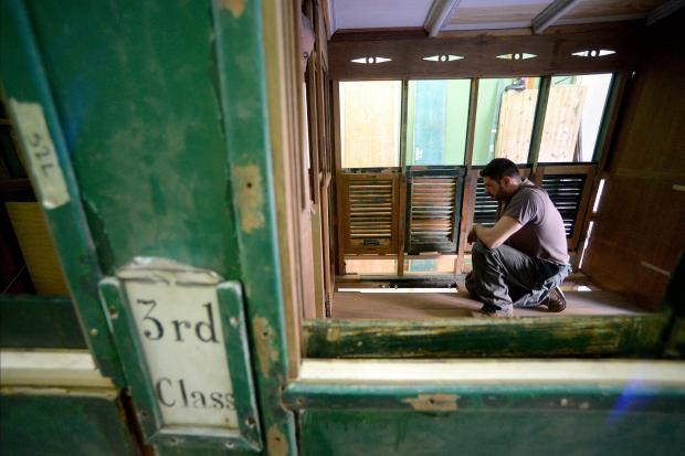 Restorer, Renald Bezzina works on the flooring of an old train carriage in his workshop in Tarxien on April 6. The third-class carriage had been left neglected at the old B'kara station before being removed over a year ago. Photo: Matthew Mirabelli