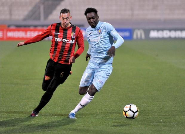 Amadou Samb (right) of Gżira United shields the ball from Ħamrun Spartans' Daniel Zerafa. Photo: Chris Sant Fournier