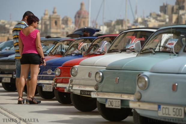 A couple admire various Fiat 500's on display at Dock 1 in Cospicua on September 6. Photo: Matthew Mirabelli
