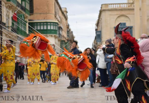 Children try to catch puppets from China's Zhejiang Wu Opera Troupe during the Chinese new year celebrations held in Valletta on February 13. Photo: Mark Zammit Cordina