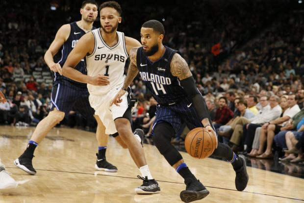 Orlando Magic point guard D.J. Augustin (14) drives to the basket past San Antonio Spurs small forward Kyle Anderson (1) during the second half at AT&T Center. Photo Credit: Soobum Im-USA TODAY Sports