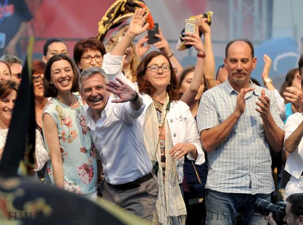 PN leader Simon Busuttil and his partner Kristina Chetcuti on stage at the PN Mass Meeting together with Marlene and Godfrey Farrugia of the PD on May 14. Photo: Chris Sant Fournier