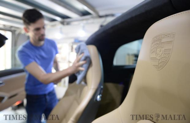 The final touches are made on a supercar which was brought in for detailing at a workshop in Mellieha on June 3. Photo: Matthew Mirabelli